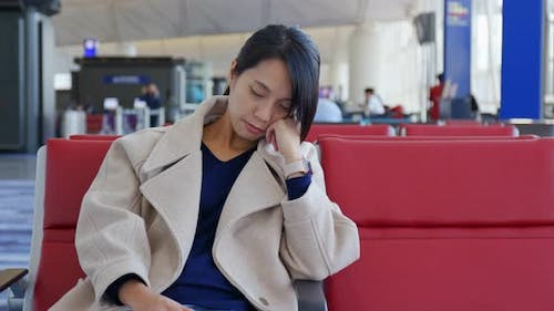 Businesswoman sleep on the wait area at the airport