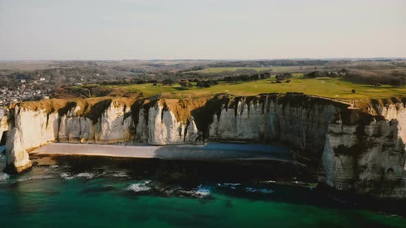 Thumbnail for Drone Is Slowly Panning Left Over Beautiful White Chalk Cliffs and Idyllic Sunset Seaside Town