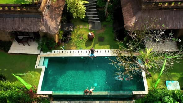 Thumbnail for Happy Family Swims and Relaxes in a Luxurious Infinity Pool in a Tropical Paradise in Ubud, Bali