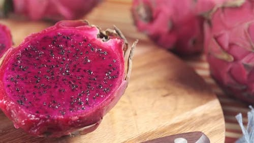 Slice of Dragon Fruit on a Chopping Board