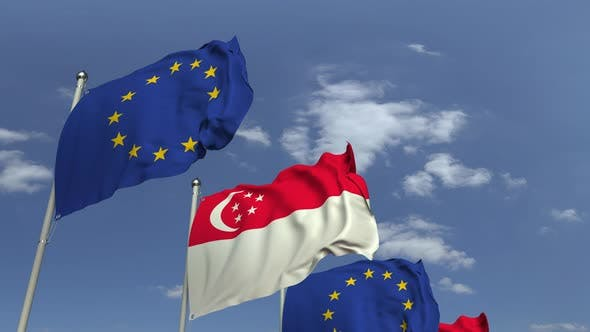 Waving Flags of Singapore and the European Union