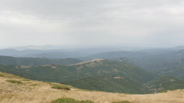 Thumbnail for Tilting over valley under Midzor peak 4K 2160p 30fps UltraHD footage - Mountain ranges of Stara plan
