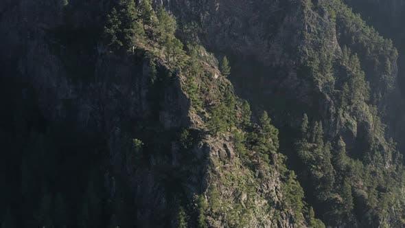 Aerial view of rocky mountain cliffs in Caldera De Taburiente national park in La Palma island