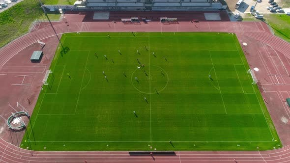 Thumbnail for Aerial Top Down View of Soccer Field and Two Professional Teams Playing