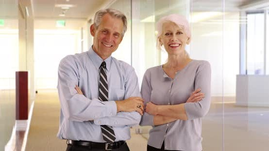 Thumbnail for Portrait of happy senior business professionals smiling at camera