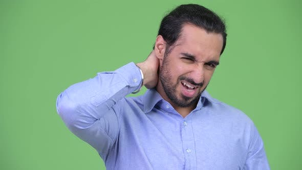 Thumbnail for Young Stressed Bearded Indian Businessman Having Neck Pain