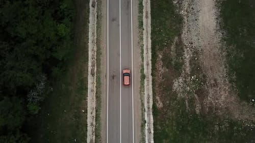 Drone Point of View Tracking Mode Aerial View Flying Over Two Lane Countryside Forest Road with