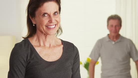 Thumbnail for Elderly couple standing in living room smiling