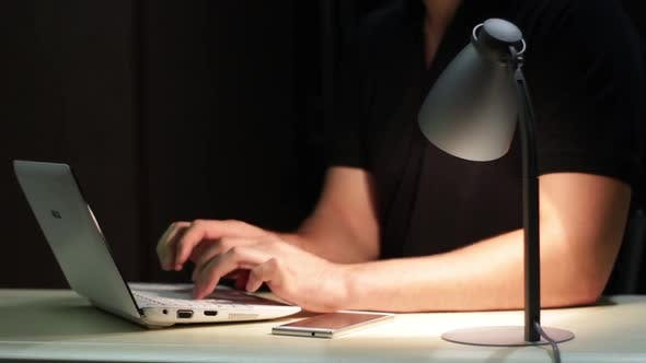 Thumbnail for Man Uses Laptop And Come In Of The Shot