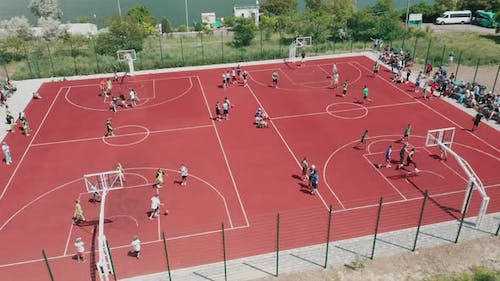 Aerial View of Young Athletes Playing Streetball on an Open Public Basketball Court