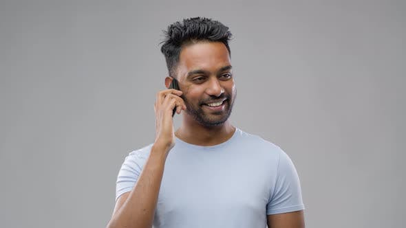Thumbnail for Happy Indian Man Calling on Smartphone 49