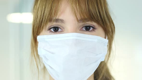 Thumbnail for Female Doctor in Mask