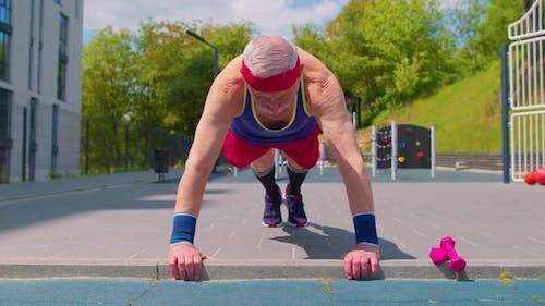 Senior Man Grandfather 80 Years Old Doing Sport Cardio Training Pushups Exercising on Playground