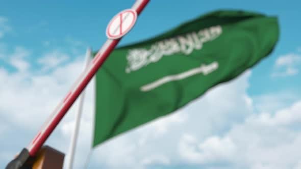 Thumbnail for Closed Gate with STOP CORONAVIRUS Sign on Saudi Arabian Flag Background