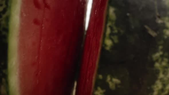 Thumbnail for Zoom in macro video of  watermelon opening into halves. Shot with RED helium camera in 8K