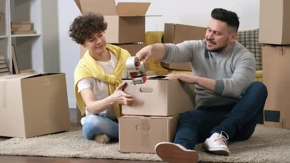 Thumbnail for 30-Something Caucasian Woman Helping Husband Pack Boxes