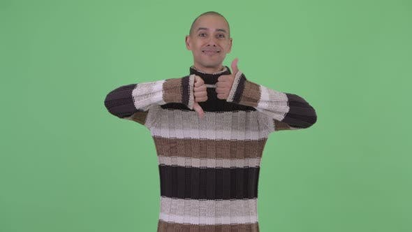 Thumbnail for Confused Bald Multi Ethnic Man Choosing Between Thumbs Up and Thumbs Down