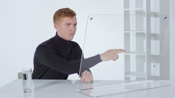 Thumbnail for Caucasian Man Using Invisible Futuristic Computer