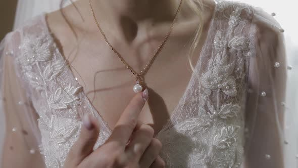 Thumbnail for Elegant Blonde Bride Wear Beautiful Necklace. Woman at Wedding Morning
