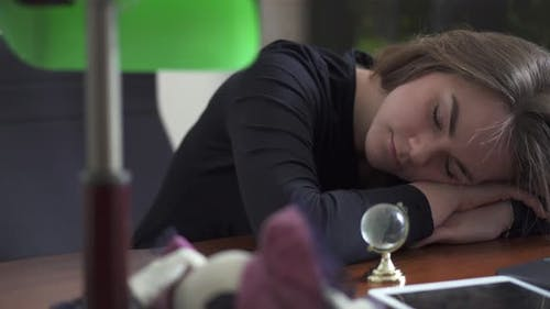 Young Woman Taking a Nap with Laptop Computer
