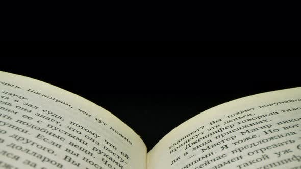 Macro Footage of Russian Words on Pages of a Book