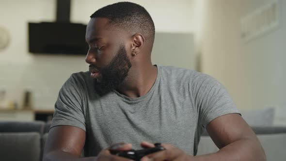 Thumbnail for Concentrated Man Playing Game at Kitchen. Frustrated Guy Holding Playstation
