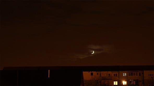 Thumbnail for Crescent Moon Over Neighborhood Timelapse