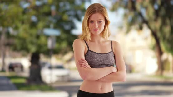 Thumbnail for Fit millennial Caucasian woman runner outdoors in park with athletic clothing