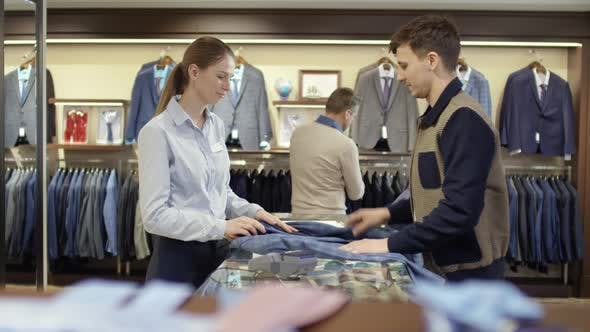 Thumbnail for Sales Assistant Advising Man Buying Suit