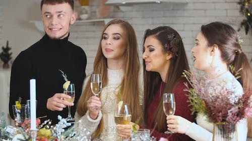a Group of Young People with Glasses of Champagne