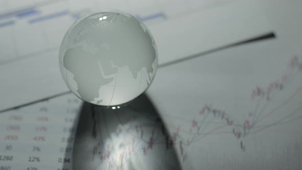Thumbnail for Glass globe with stock charts