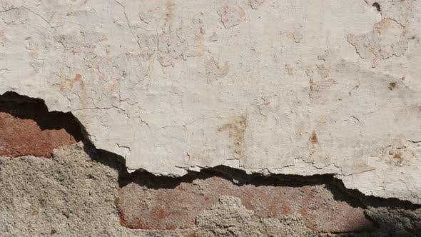 Old  destroyed building facade 4K 2160p 30fps UltraHD tilting footage - Slow tilt obsolete brick wal