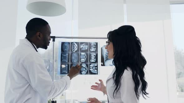 Thumbnail for Two Doctors are Looking at X-rays