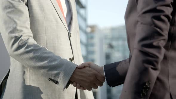 Thumbnail for People Wearing Formal Wear Shaking Hands Outdoor
