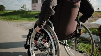 Disabled Woman on Walk in the Town