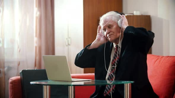 Thumbnail for Elderly Grandfather - Grandfather Is Holding Headphones with His Hands and Enjoying Music
