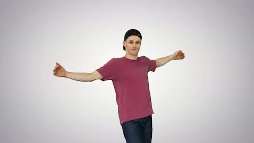 Hip-hop Guy in a Cap Dancing on Gradient Background.