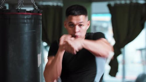 Young Man Shadow Boxing to a Camera