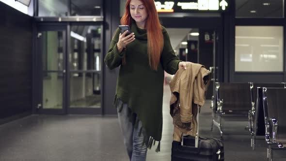 Thumbnail for Female Traveler Lands Flight and Uses Smartphone