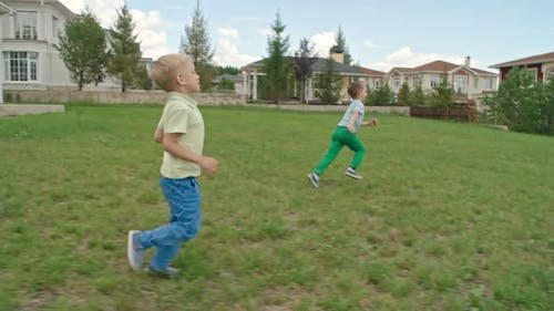 Playing Soccer on the Lawn with Father