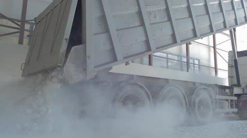 Dumper-truck unloading crushed rocks