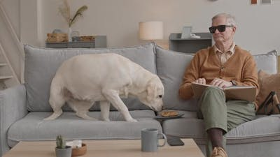 Old Man with Dog at Home