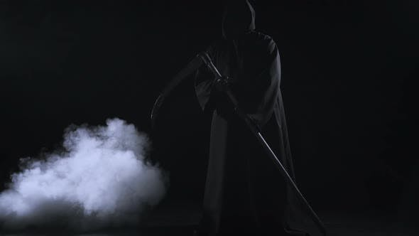 Thumbnail for Horrible Dark Figure In A Hoodie With A Scythe