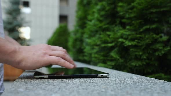 Thumbnail for Close-up view of man's fingers typing on the tablet PC