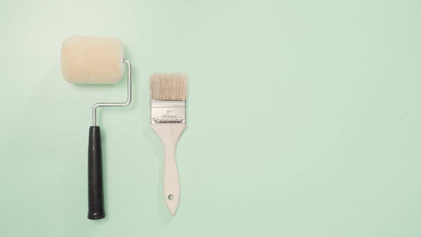 Thumbnail for Paint brush and roller for house painting project.