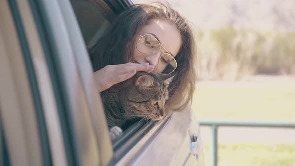 Thumbnail for Smiling Lady with Funny Tabby Cat Leans Out of Car at Field