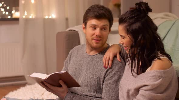 Thumbnail for Happy Couple Reading Book at Home