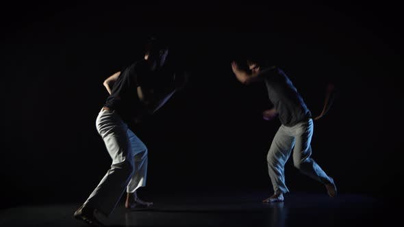Two Men Are Performing Martial Art of Capoeira