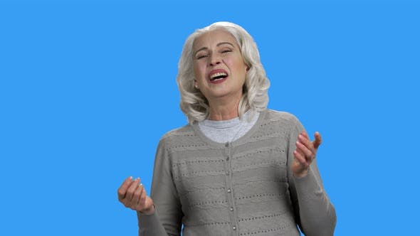 Happy Woman is Laughing on Color Background