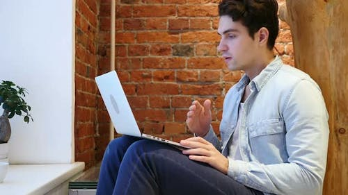 Shocked Young Man, Amazed by Surprise on Laptop